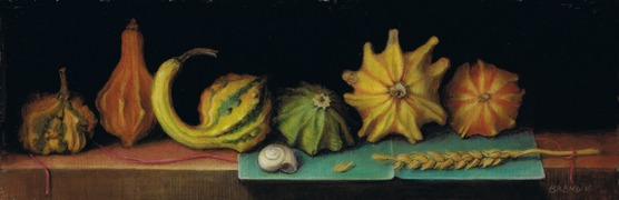 Gourds, wheat and snail on a table