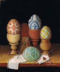 Painted eggs in wooden antique egg cups